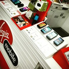 The smartphone control and display system spotted at a Virgin Mobile kiosk in Canada Mobile Kiosk, Tape, Smartphone, Retail, Canada, Display, Simple, Billboard, Duct Tape