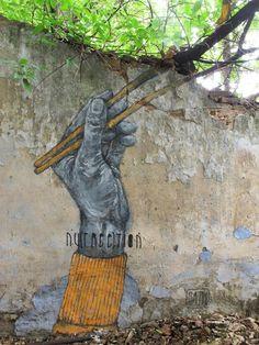 Du-street-art-qui-interagit-avec-son-environnement-par-Sath-2