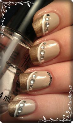 I love the design . . . just not the colors!  Nails with bling rock!