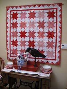 Red, white, and pink quilt, picture from Pam Kitty Morning's blog. Great inspiration! No pattern.
