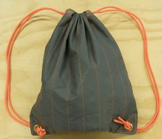 Sew a Durable Drawstring Bag. Would be a good cheap backpack to donate to homeless or other shelters. Durable and compactable.