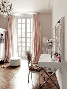 Wish I had this makeup table. I also love the wooden floors + chandelier + french window/curtain.
