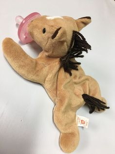 Dootsies Pacifier Lovie TY Beanie Baby (wubbanub)    eBay derby the horse.   Pacifier for baby to toddler binkie is permanently attached and the whole thing is machine washable the slight weight keeps the binkie in place for newborns. And the beanie baby becomes a friend to your growing toddler. Your baby's first best friend.