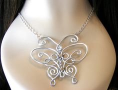 Regal Butterfly Necklace by RefreshingDesigns on Etsy, $28.00. Super cute. I hope that someday, I'm this good with wire.