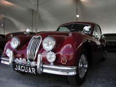 ...vintage automobiles; would LOVE to get behind the wheel of this Jaguar