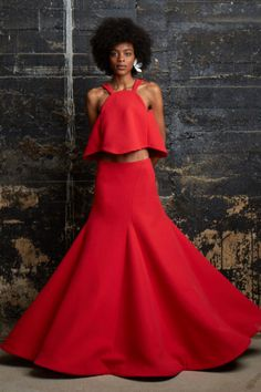 And as far as that drama, a full red, drop waist maxi dress, paired with an A-line matching tank brings just that. It's a gown, but not a gown—one seen through the very original lens of Rosie Assoulin. —Kerry Pieri