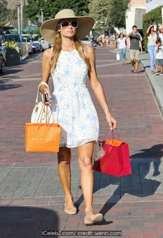 Paris Hilton and sister Nicky Hilton shop at Malibu Country Mart http://icelebz.com/events/paris_hilton_and_sister_nicky_hilton_shop_at_malibu_country_mart/photo4.html