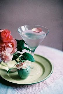 Rose Martini    1 1/2 oz. vodka  1 oz. white crème de cacao  1/4 oz. rosewater  1 drop rose food color    ~ fill half of a cocktail shaker with ice,  add liquids and shake  ~ pour into chilled martini glass  ~ garnish with rose petal or turkish delight