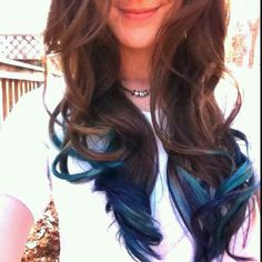 Messy brunette hair with her tips dip blue...