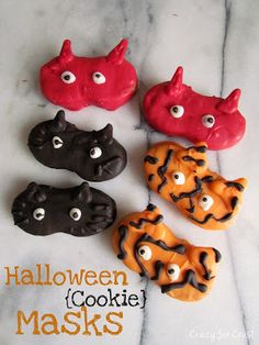"""Halloween Masks,"" from Crazy for Crust. -- Kitty cats, tigers, and devils, oh my!"