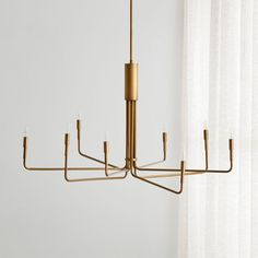 Sale ends soon. Our Blake Tovin design edits down the classic chandelier to its sleekest elements, instantly transforming dining areas with its clean, contemporary silhouette. Room Lights, Hanging Lights, Ceiling Lights, Bronze Chandelier, Modern Chandelier, Chandeliers, Diy Home, Home Decor, Slanted Ceiling