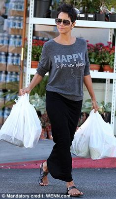 Fashion statement: The actress wore a top reading 'Happy Is The New Black' during the outing in West Hollywood