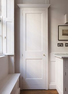 plain english - merchant's house - kitchen: shutters + cupboards + marble More