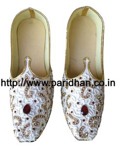 Designer wedding mojari made in white color brocade fabric and thin synthetic sole. These are Handmade Men Wedding Mojari Jutti. They will take the shape of the feet as you wear them. Both shoes in a pair are identical. They will take the shape of the feet as you wear them. Upper Made from white color brocade fabric. They have curved toe to give them a traditional and Royal Look. These khussas are made of Flat and thin synthetic soles. Handcrafted by the shoe makers of Rajasthan, India.