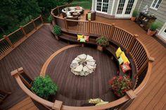 Love this garden decking design... Wonder about having a wooden upper wrapped around patio stone below?