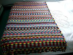 Why not use up all those left-over yarn scraps to make a brightly-colored crocheted blanket? An easy project for frugal crocheters.