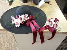 Orchid flower on hat and corsage