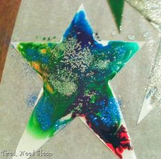 Epiphany star - corn syrup glob in the middle - spread to edges, add drops of food coloring and swirl... add glitter if desired.  Takes a long time to dry, but is very shiny!