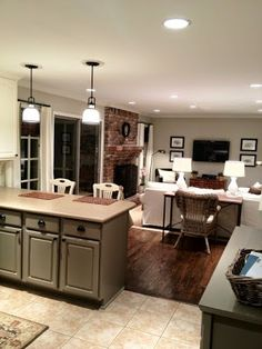Kitchen Living Room Kitchen tiles, wood flooring, brick fireplace, khaki paint, frames around tv. Kitchen Tiles, Kitchen Flooring, Wood Flooring, Kitchen Wood, Wood Tiles, Flooring Ideas, Kitchen Island, Open Kitchen, Taupe Kitchen