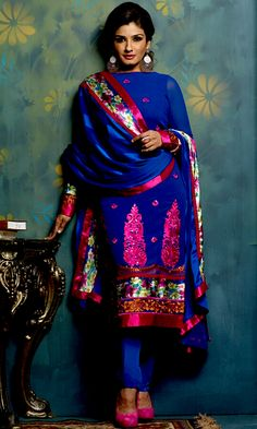 Ultimate collection of embroidered suits with fabulous style. The dazzling blue georgette churidar suit have amazing embroidery patch work is done with resham and sequins work. The entire ensemble makes an excellent wear. Matching churidar and dupatta is available with this suit. Slight Color variations are possible due to differing screen and photograph resolutions.