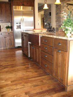 Sumptuous apron sink in Kitchen Traditional with Chestnut Stain next to Apron Front Sink alongside Copper Sink and Stainless Steel Appliances