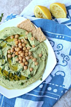 The ultimate collision of two of the best dips! This spinach artichoke hummus comes together in under 10 minutes and is packed with flavor and fun!