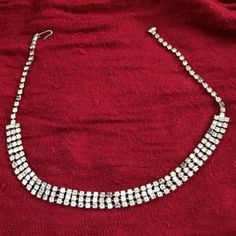 Vintage Rhinestone Necklace This Rhinestone necklace has three rows of rhinestones. All stones are intact. There are some dead stones, shown, and this piece is priced accordingly. They do not detract from this necklace when worn; it is still a dazzling piece and add to its vintage charm. Price is firm on this item. Vintage Jewelry Necklaces