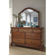 Panama Jack Isle of Palms 7 Drawer Dresser with Mirror Finish: Brown