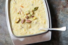 This cardamom-scented Indian rice pudding owes its richness to whole milk, reduced by half, which yields a thick, creamy base. - I LOVE rice pudding. This is excellent rice pudding. Indian Dessert Recipes, Indian Sweets, Asian Recipes, Sweet Recipes, Indian Rice Pudding, Indian Pudding Recipe, Rice Kheer, Glutinous Rice, 13 Desserts