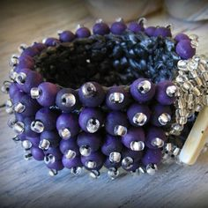 DBANE WOOD      wood and glass beads on crocheted raffia base  ZAR 375 available in all colours