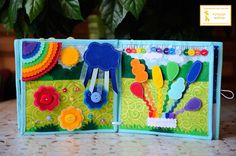 """4. Страничка """"радужная"""" Учим цвета радуги, учимся одевать цветочки на пуговки, под пуговкой - бусинка( для более удобного одевания. Начинается дождь, большие капли падают на травку, потом выходит солнышко и появляется радуга))) Ищем одинаковые цвета на радуге, шариках, на ленточке у подставки)шарики на липучке. Перебираем пуговки пальчиками и сравниваем их (большие - маленькие)"""