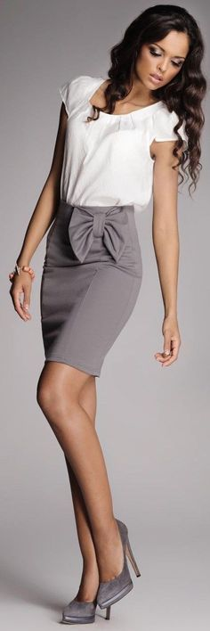 grey skirt. white top. soft curls. feminine and professional. Not crazy about the bow but the color scheme is good!