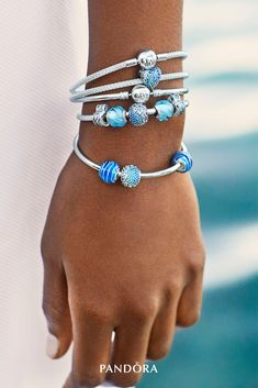 Let these water-inspired charms sparkle on your bracelet this season. Aqua blue enamel and dazzling stones decorate their sterling silver core, all masterfully finished by hand.