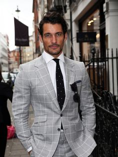 David Gandy on Day Two of London Collections: Men SS '15 wearing a windowpane check suit by Marks and Spencer Best of British Collection. June 16, 2014