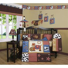 Decorate your little cowboys nursery with this Western crib set for a complete nursery. The 13-piece set includes one quilt, bumper pad, crib skirt, fitted sheet, two valances, diaper stacker, two throw pillows, three wall hangings, and a toy bag.