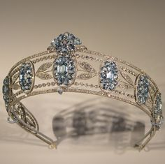 BELLE EPOQUE AQUAMARINE AND DIAMOND TIARA, CIRCA 1910. Designed as a series of graduated oval aquamarine clusters set with oval- and hexagonal-shaped aquamarines, interspersed with sprays of diamond myrtle leaves, within millegrain borders of circular-, single- and rose-cut diamonds. Part of the estate of Christian, Lady Hesketh. Cartier