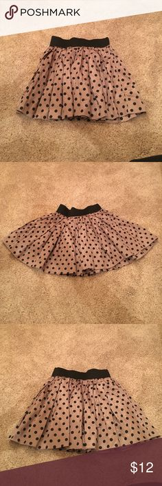 NEW Charlotte Russe short polka dot skirt in Small BRAND NEW Charlotte Russe short polka dot skirt in tan and black in size small. It features a black elastic band waist. The skirt has a little shimmer to it. Charlotte Russe Skirts