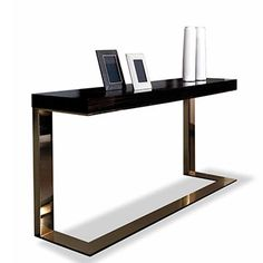 Kelly Console, Dom Edizioni  Gloss makassar ebony veneered top Metal base: gloss brass plated / gloss chromed / bronzed  Dimensions:  cm.160x40x77H cm.195x40x77H cm.230x40x77H