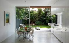 A kitchen with an outdoor/ indoor concept.. private with the enclosed garden or backyard..