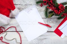 The blank sheet of paper on the wooden table with a pen  stock photo (c) master1305 (#6349433) | Stockfresh