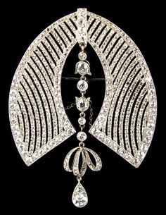 French platinum and diamond brooch, circa 1920, with old brilliant and rose cut diamonds, 2.3 inches high.