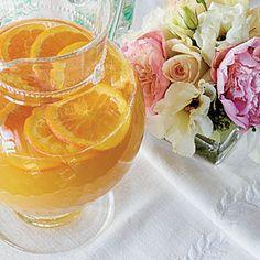 Pineapple-Orange punch. Replace orange juice for 2 quarts of orange sherbet. http://www.myrecipes.com/recipe/ginger-orange-mocktails-50400000111544/