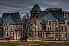 Ohio State Reformatory operated between 1886-1910. It was closed down in 1900 and is now a museum. Both chapels on the grounds, the infirmary and solitary confinement cells are rumored to be haunted. More than 200 people died in the prison, and some of them still seem to be hanging around. Apparitions of guards and prisoners asking for help have been seen, and there have been reports of slamming cell doors and the sound of people running when no one is there.