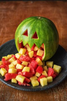 """Watermelon Jack O' Lantern-- Perfect for your spooky Halloween party. Who doesn't love a festive fruit salad. Use code """"HELLOPINTEREST"""" for $25 off your first HelloFresh box."""