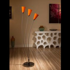 Stunning tulip standard floor light with glass orange conical shades.  A truly stunning item with 3 beautiful glass shades and heavy nickel chrome base.  Made by Europe's top lighting manufacturer, please do not confuse with cheap Asian copies.