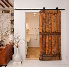 Sliding Barn Door in the House :).  For the kids playroom
