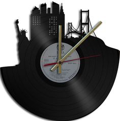 """Clock made from vinyl 12"""" single or album.  These are suitable for wall mounting   Available for your consideration is a wonderful upcycled vinyl reco"""