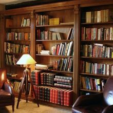 Oak bookcase-wall designed and installed in a Somerset Manor