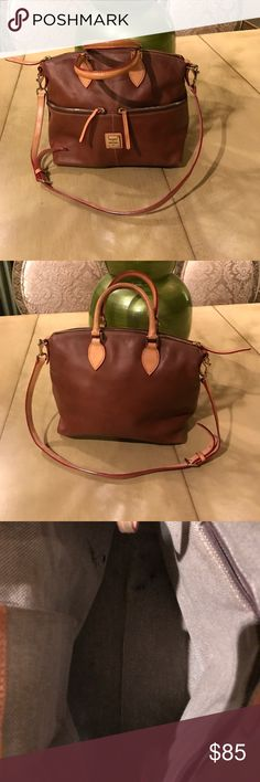 Dooney and Bourke leather handbag This is authentic leather stunning Handbag with gold hardware. Two shades of leather light and dark brown. It does have pen mark inside as shown in pictures but nothing major. The bottom of bag has slight wear but nothing u can see and most Dooney and Bourke bags because of the leather have those on corners. This is a rare find Handbag. Dooney & Bourke Bags Satchels