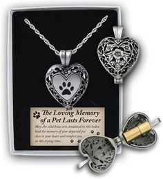 The Cathedral Art Paw Print Memorial Ashes Locket Necklace keeps your beloved pet with you always. The loss of a pet is one of the most difficult things you can face, and this necklace offers a beautiful way to honor and remember your pet. Featuring a tiny brass urn that is carefully clipped inside the locket, it's made to hold a small portion of their ashes to keep the memories close to your heart. The outside is adorned with a paw print and filigree design, serving as a comforting and…